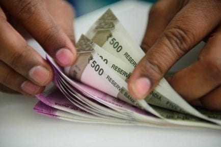 Rupee Gains 39 Paise Against Dollar Amid Plunging Crude Prices