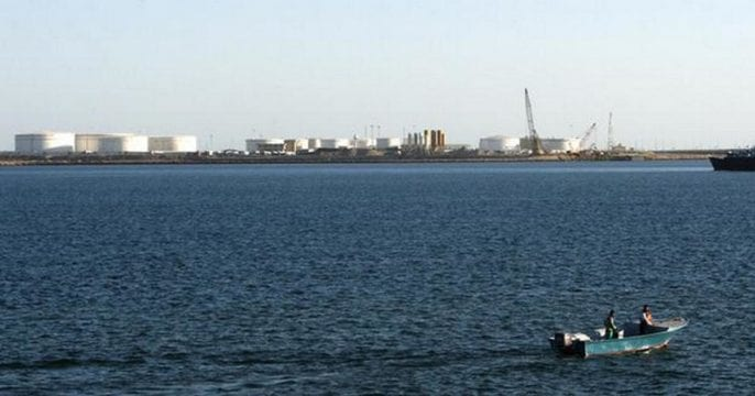 A speed boat passes by oil docks at the port of Kalantari in the city of Chabahar